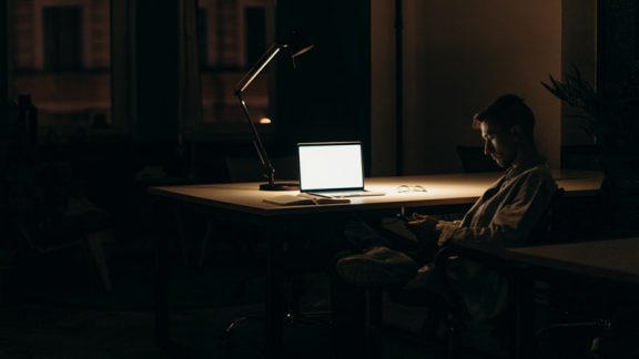 Remote-Scrum-Teams-Man-at-home-working-extra-hours-at-night